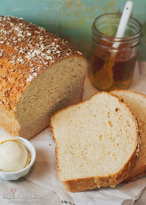 Homemade Honey Oat Bread (You brush the top with warm honey and sprinkle the top with rolled oats before baking. So good!)