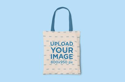 Placeit - Mockup of a Sublimated Tote Bag with Customizable Strap on a Colored Surface