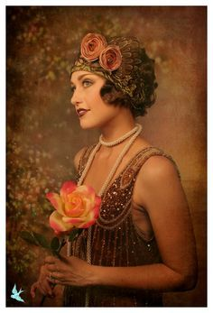 This vintage flapper is dressed in gold and flowers. Flappers usually dress in one or two colors to look put together. Bold lipstick was also popular in the They wanted their makeup to stand out.