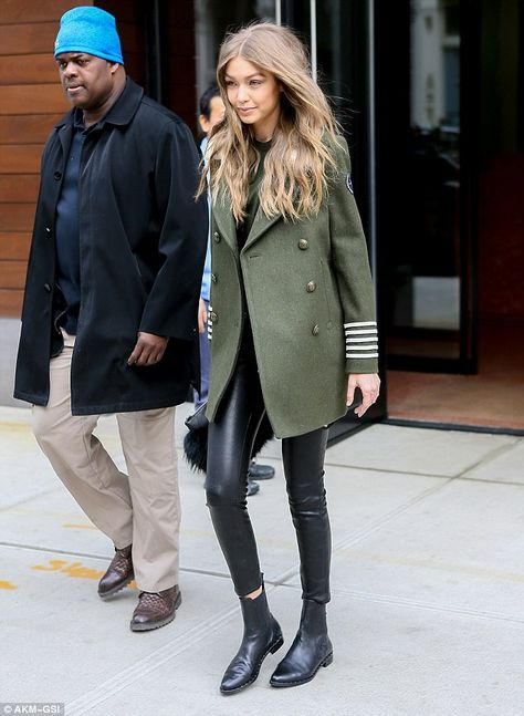 Gigi wearing TOMMYXGIGI Shearling-Collar Military Peacoat, skin-tight FRAME stretch leather trousers and Freda Salvador boots leaving her apartment in New York's Tribeca neighborhood on Feb