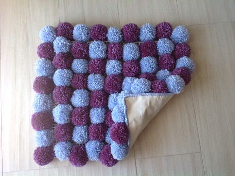 """Small two colored """"pompom"""" rug"""