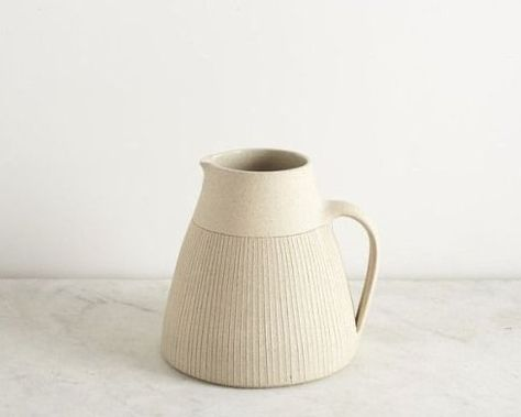 Simple, modern, off-white, handmade ceramic pitcher with ridged edges and texture. Perfect for a minimalist kitchen. Ceramic Pitcher, Ceramic Tableware, Ceramic Clay, Ceramic Pottery, Ceramic Jugs, Slab Pottery, Pottery Vase, Porcelain Ceramics, Earthenware