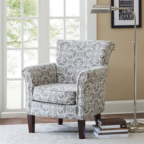 This club chair features a loose seat and tight back combined with a modernized lacey geometric pattern that is highlighted with pops of silver nail head. Some assembly required.
