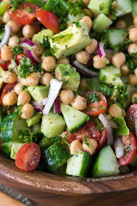 Adding chickpeas to this salad definitely packs a protein punch! What a great way to enjoy fresh summer veggies and it's the perfect make ahead lunch! #spendwithpennies #chickpea #chickpeasalad #saladrecipe #makeaheadsalad #lunchrecipe #easyrecipe #easysidedish #potluck #bbq
