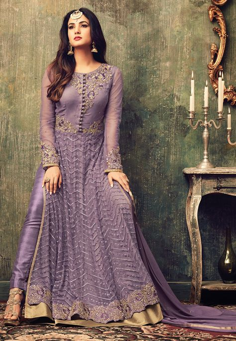 Semi-Stitched Net Abaya Style Kameez in Lilac This Round Neck and Full Sleeve attire with Poly Shantoon Lining is Prettified with Resham, Zari, Stone, Sequins and Patch Border Work Available with a Poly Shantoon Straight Pant and a Faux Chiffon Dupatta in Lilac The Kameez and Bottom Lengths are 60 and 42 inches respectively Do note: The Length may vary upto 2 inches. Accessories shown in the image are for presentation purposes only.(Slight variation in actual color vs. image is possible).