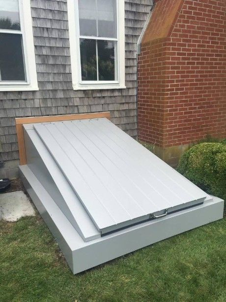 Foundation Wrap Covers The Original Concrete Foundation Eliminating Additional Masonry Work Everlast Aluminum Bulkhead Doors Cellar Door Storm Door Makeover