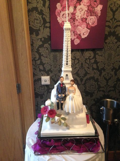 Eiffel Tower tiered wedding cake with bride and groom modelled ...