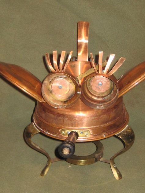 metal yard art,sculptures,garden art,found object.recycled art metal, sculpture art, copper. $65.00, via Etsy.