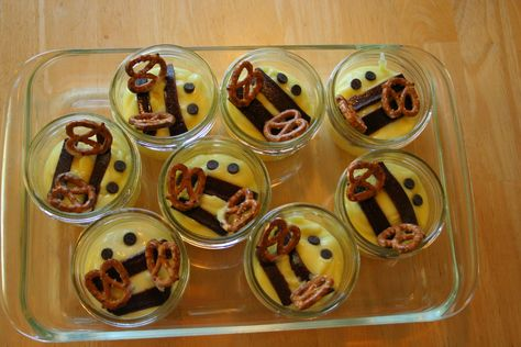 Bee snack I made for our Daisy meeting, Chapter 2 of the Flower Journey.  Lemon pudding, with chocolate chip eyes, pretzel wings, and all natural fruit strips (dark colors) for the stripes.