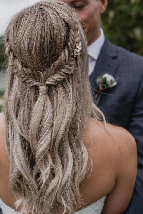 Loving the simple elegance of this bridal fishtail braid. #weddingbraids #hairstyles