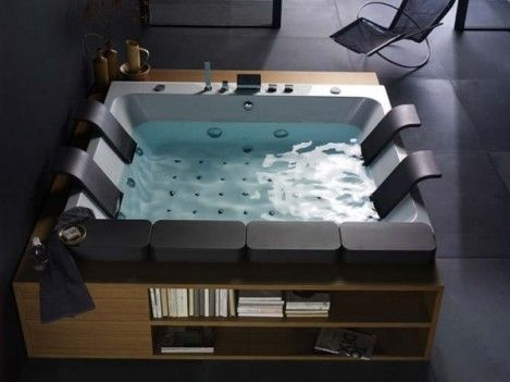Huge Bathtub Tons Of Jets Built In Bookcase And A Waterfall