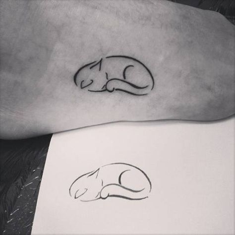 Sleepy cat tattoo on the foot. Tattoo artist: Ivy Saruzi