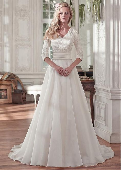 Elegant Tulle & Organza Satin V-neck Neckline A-line Wedding Dresses With Beaded Lace Appliques Fabric: tulle & organza satin Details: Demure and sophisticated, this elegant A-line wedding dress offers a gorgeous beaded lace-appliqued tulle bodice, pleated romance satin waist, and soft organza satin skirt.