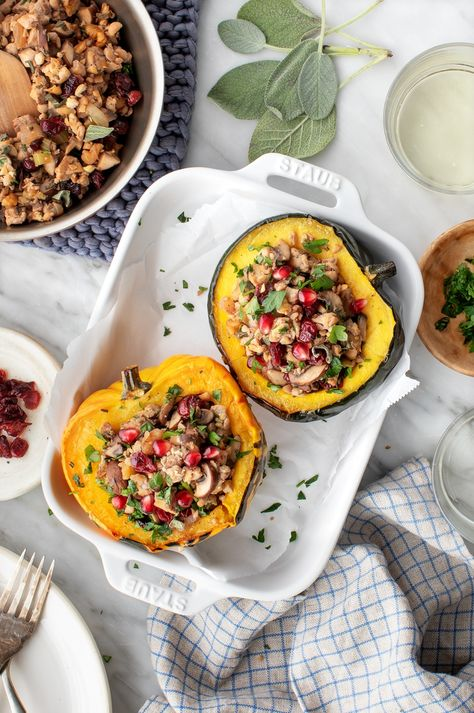 This stuffed acorn squash recipe is the ultimate fall dinner! Loaded with an herbed mushroom filling, it's flavorful, healthy, and perfect for the holidays. Vegan and gluten-free.   Love and Lemons #squash #stuffedsquash #holidayrecipes #dinnerideas