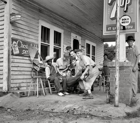 """Dorothea Lange 1939. """"Fourth of July near Chapel Hill, North Carolina. Rural filling stations become community centers and general loafing grounds. The men in the baseball suits are on a local team which will play a game nearby. They are called the Cedargrove Team."""