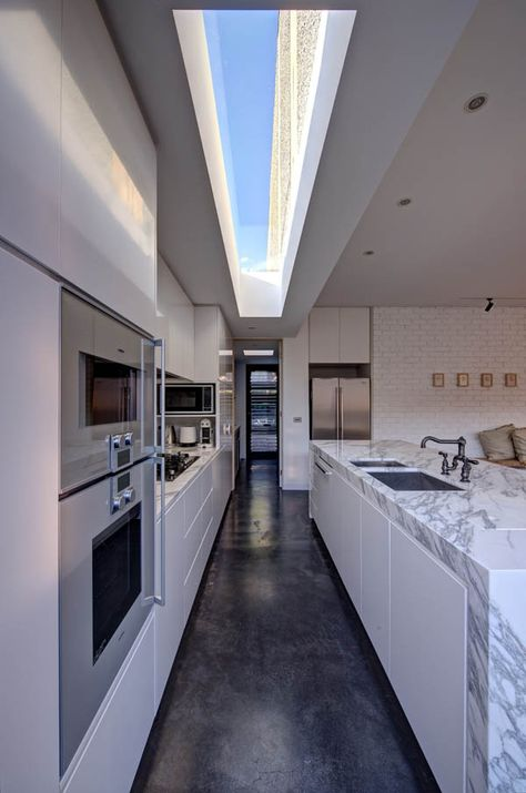 Skylights in the right places can be amazing, like in this kitchen in home in Australia designed by Jessica Liew