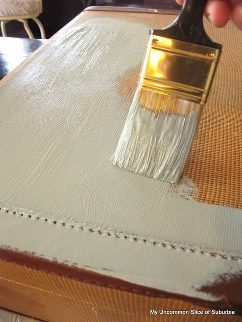 A tutorial on how to paint an old suitcase by Kristin of My Uncommon Slice of Suburbia.
