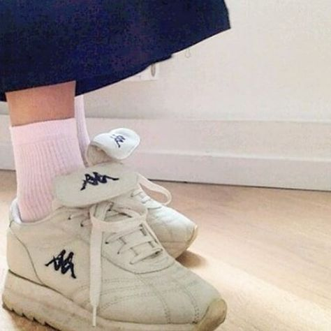 1cc42407833b a photo of someone wearing dirty white sneakers with pink socks ...