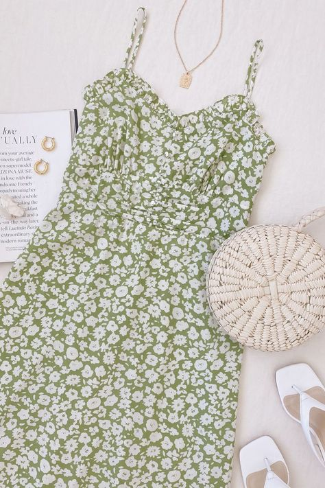 Lulus Exclusive! For the ultimate chic choice, choose the Lulus X LUSH Timeless Touch Green Floral Print A-Line Midi Dress! Light and breezy, green and white ditsy floral print woven fabric adds retro appeal to this classic sundress with adjustable skinny straps, a ruffle-trimmed neckline, and a button-front bodice with a ruched, set-in waist. A-line midi skirt finishes off this closet essential. #lovelulus