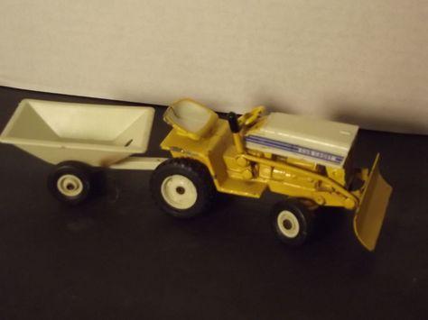 a342b2eb420da420ca4483fc85de1c68 farm toys diecast vintage ertl cub cadet lawn tractor diecast toy w plow and trailer Cub Cadet 100 at n-0.co