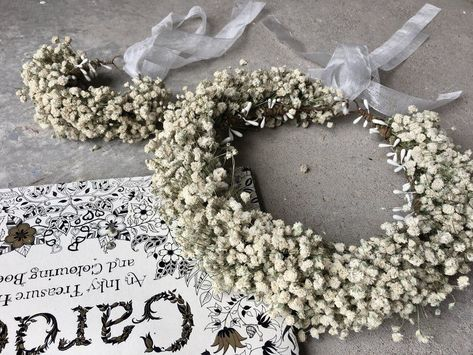 We love this romantic dried baby's breath flower crown that can be worn by with a bride, bridesmaid, or flower girl hairstyle! Click through for more rustic wedding inspiration. #rusticwedding #weddinghairstyles #flowercrown #weddingflowercrown #weddinghairaccessories