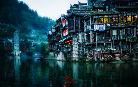 Here's a place that's pretty tough to get to called Fenghuang in far southern China. It was a great place to explore and take photos... I think I was the only white person I saw while there, and that really makes me feel like I'm in a fairly unexplored place. When I wasn't taking photos, I carried around my sketch pad and worked on my drawings... they aren't really that great, but this is just when I was learning to sketch. #TreyRatcliff #China #Fenghuang #travel #river