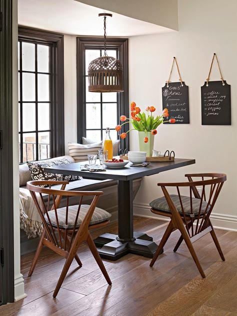 It's easy to turn a window seat into a breakfast nook—just add a table! #breakfastnookidea #eatinkitchen #breakfastnookbench #bhg