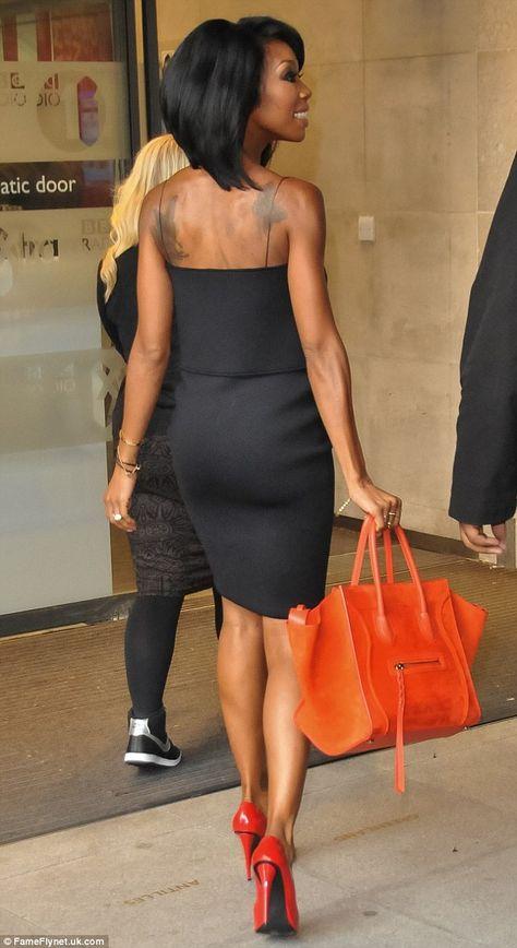 Brandy wearing a Jen Kao Black Origami Fold Dress and red Giuseppe Zanotti heels. Celine bag in