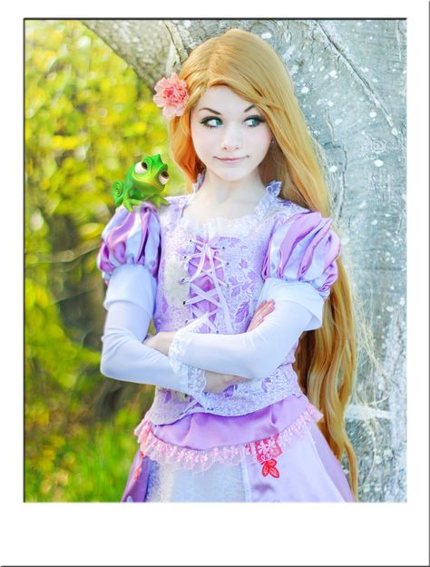 TANGLED RAPUNZEL COSTUME WIG. Extra long, golden blonde wig measures 41 inches in length and features gorgeous natural wavy hair and side parting. Sewn into a fully adjustable cap. Perfect for any cosplay or Halloween Rapunzel costume requiring an authentic look. Available now from Star Style Wigs with worldwide shipping and free UK delivery. Click the image for more info.