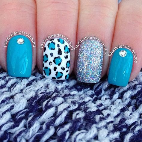 Cute blue and leopard nails.