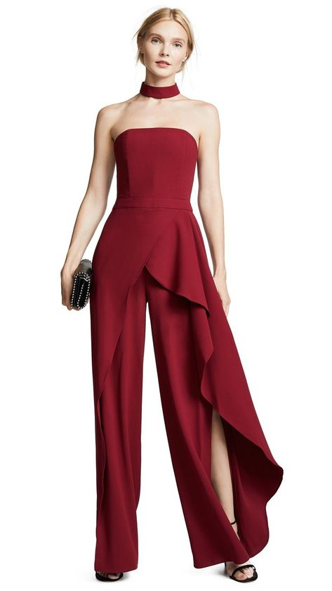Fabric: Crepe Boning at bodice Stretch paneling at back bodice Removable collar Slits at sides Full length Exposed zip at back Hook-and-eye at back Partiall