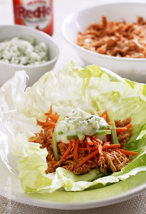 Crock Pot Buffalo Chicken Lettuce Wraps - A great low-carb, gluten free way I like to eat this is in a lettuce wrap topped with shredded carrots, celery and blue cheese dressing. Plus, making the chicken in the slow cooker is super easy! 3points+ #glutenfree