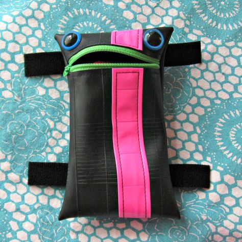 Was looking for a top tube bag, and found this adorable guy - made from recycled bike tires! In a slightly different shape, it would make the best tri bag ever. I have to believe it would be good for a smile, even after 112 miles. :-)