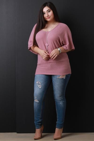 This plus size top features a soft knit fabrication, scoop neckline, dolman sleeves, and wide banded hemline. Top comes with a detachable necklace. Other accessories sold separately. Made in U.S.A. 55% Polyester, 32% Rayon, 8% Cotton, 5% Spandex.Measurement Size Bust Hem Lengh Sleeve 1X 42 17 28 8 2X 44 19 29 9 3X 46 21 30 10