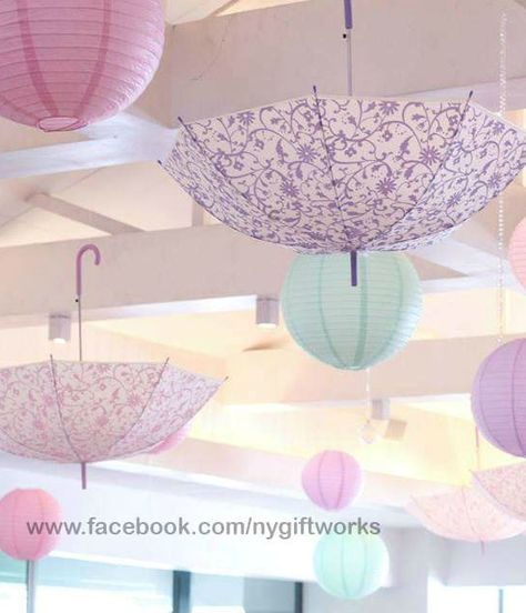 Baby shower rain umbrella theme inspirations on pinterest for Baby shower umbrella decoration ideas