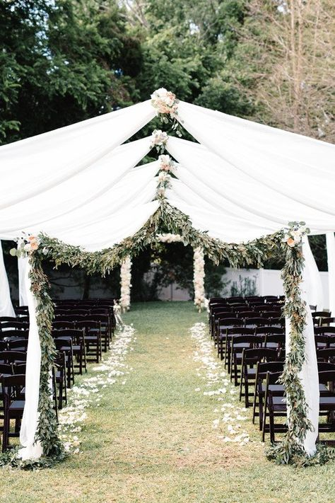 Outdoor wedding ceremony - white fabric and greenery arches {Blue Ribbon Weddings}