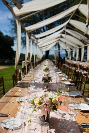 Beauty Was Everywhere At This Rustic Romantic Winery Wedding Guests Dined At King Tables Under Custom Ten Winery Weddings Beautiful Chandelier Rustic Wedding