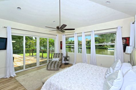 The Spacious Master Suite Opens To The Deck Through Sliding Glass Doors And Large Windows Provide Great Views Two Lar Luxury Real Estate Luxury Homes Sarasota