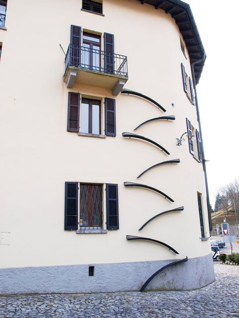 Cat ladders: a creative solution for felines in flats –   Strategically placed ramps and ladders for urban cats are all the rage in Bern. Brigitte Schuster's photo book Swiss Cat Ladders documents the phenomenon. PIC: Apartment building with cat ladders in Brè Lugano, Switzerland