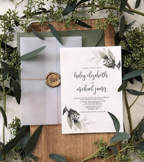 This modern, elegant wedding invitation with RSVP card set features gold and greenery design and dramatic calligraphy typeface. The real beauty is the vellum wrap accented with twine and wax seal that makes such an impressive display and timeless sophistication. THE PRICE SHOWN HERE IS FOR THE