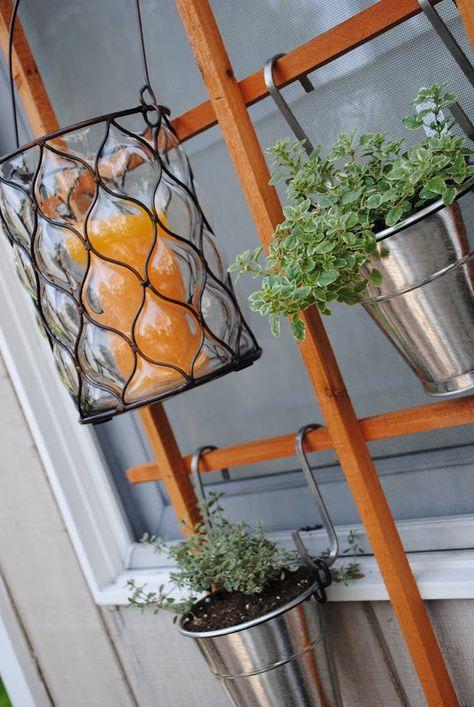 DIY Deck Idea: Use a trellis and hang small pots of herbs and lanterns