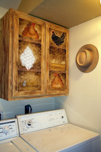"""I faux woodgrained plain cabinets and added Trompe l'oeil """"chicken coop"""" on wall above washer and dryer.   JW"""