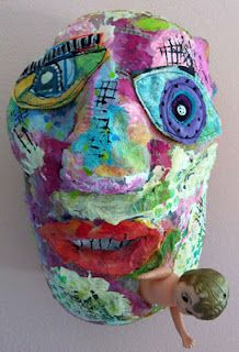 """Allison Stilwell is the artist who does the """"Recycled Heads"""" found in Cloth, Paper, Scissors magazine.  She has a short video of how she uses plastic shopping bags, melted with a head gun, to make the base for her heads.  Then gel medium and decoupage on top."""