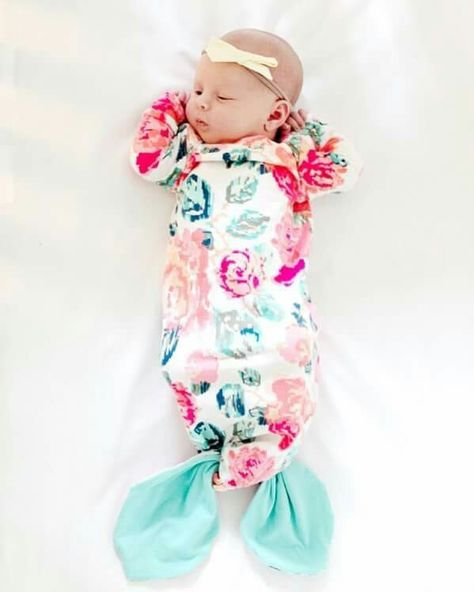 The MERMAID version of the baby gown pattern is my favorite. The hem knots into a little tail   This was such a fun pattern to design and even more fun to tie on my little mermaid! And then we took a million photos and posted almost all of them.  + more sizes coming in a few weeks! #seekatesewbabygown http://seekatesew.com/mermaid-baby-gown-tutorial-owlet-smart-sock-promo/
