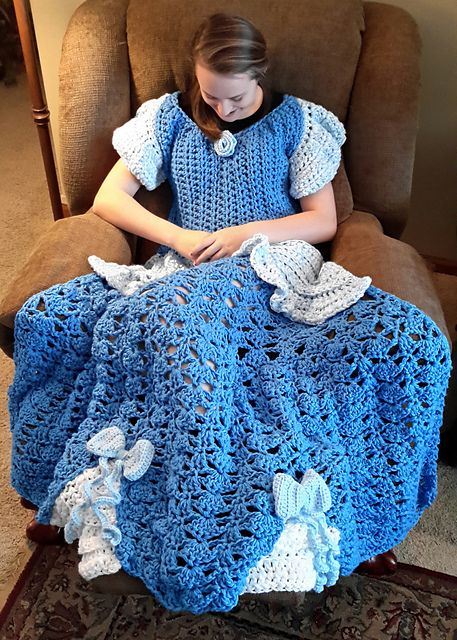 This blanket is designed to look like a princess dress, just slip your arms in and feel like a princess!