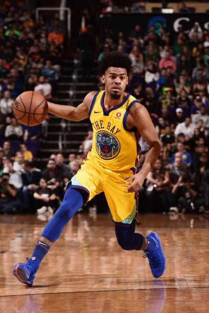 Quinn Cook Of The Golden State Warriors Handles The Ball During The Game Against The Phoenix Suns Golden State Warriors Warrior Golden State Warriors Pictures