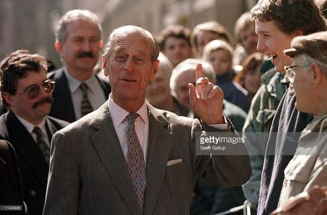 Prince Philip of England shares a laugh with locals during a walking tour of the ancient Czech town of Kutna Hora on the second day of a three day visit by the British royal couple to the Czech Republic March 28, 1996.