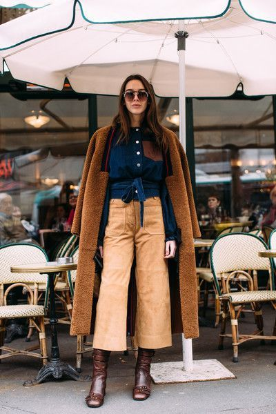 Paris Fashion Week Fall 2018 Attendees Pictures : Culottes with brown boots and off the shoulder tan fuzzy coat.