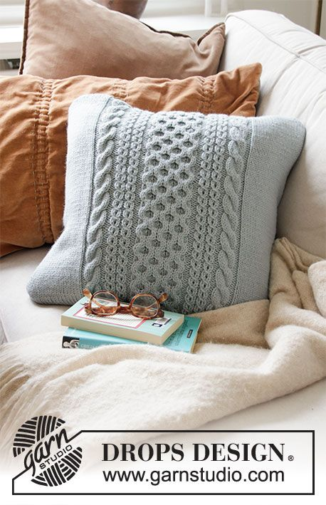 Knitted DROPS pillow case with cables