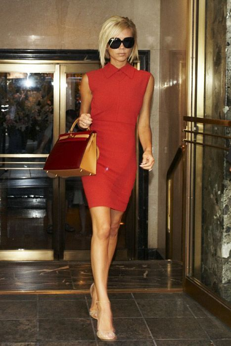 Who made Victoria Beckham's red dress, red purse, black